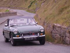 Green MG on corner of country road